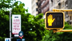 Street sign displaying a yellow hand